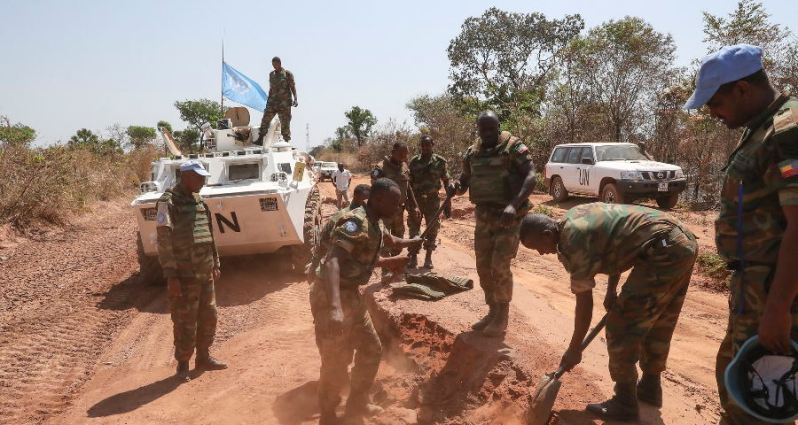 United Nations troops inspecting a road