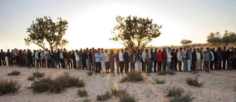 a queue of people in the desert